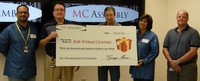 MC Assembly Donates More Than $31,000 to Local Kids Without Christmas Charity