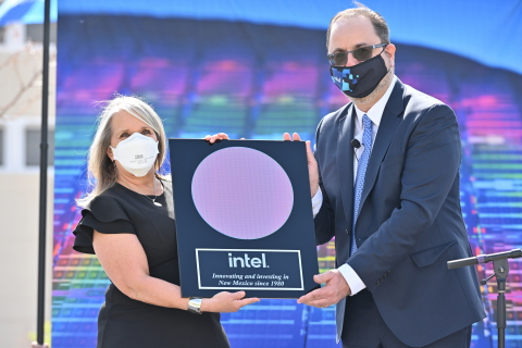 New Mexico Gov. Michelle Lujan Grisham (left) and Keyvan Esfarjani, Intel senior vice president and general manager of Manufacturing and Operations, display a plaque with a processor wafer on Monday, May 3, 2021, at the Intel Campus at Rio Rancho, New Mexico. During a news conference, Intel announced it will invest $3.5 billion in its New Mexico operations in support of advanced semiconductor packaging technologies. (Credit: Walden Kirsch/Intel Corporation)