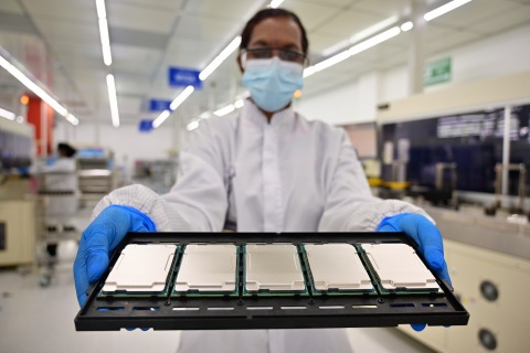 Intel manufacturing technicians in Kulim, Malaysia, display 3rd Gen Intel Xeon Scalable processors during their production cycle. Intel introduces the 3rd Gen Intel Xeon Scalable processors (code-named
