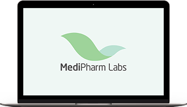 MacBook laptop with the MediPharm Labs logo on the screen