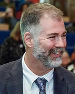 Greg A. Johnson