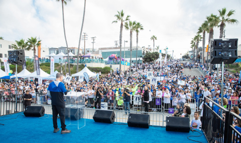 Skechers Pier to Pier Friendship Walk Co-Founder Michael Greenberg rallied thousands of walkers at the 11th annual event. The Walk broke donation records, raising over $2.2 million for children with special needs and education. (Photo: Business Wire)