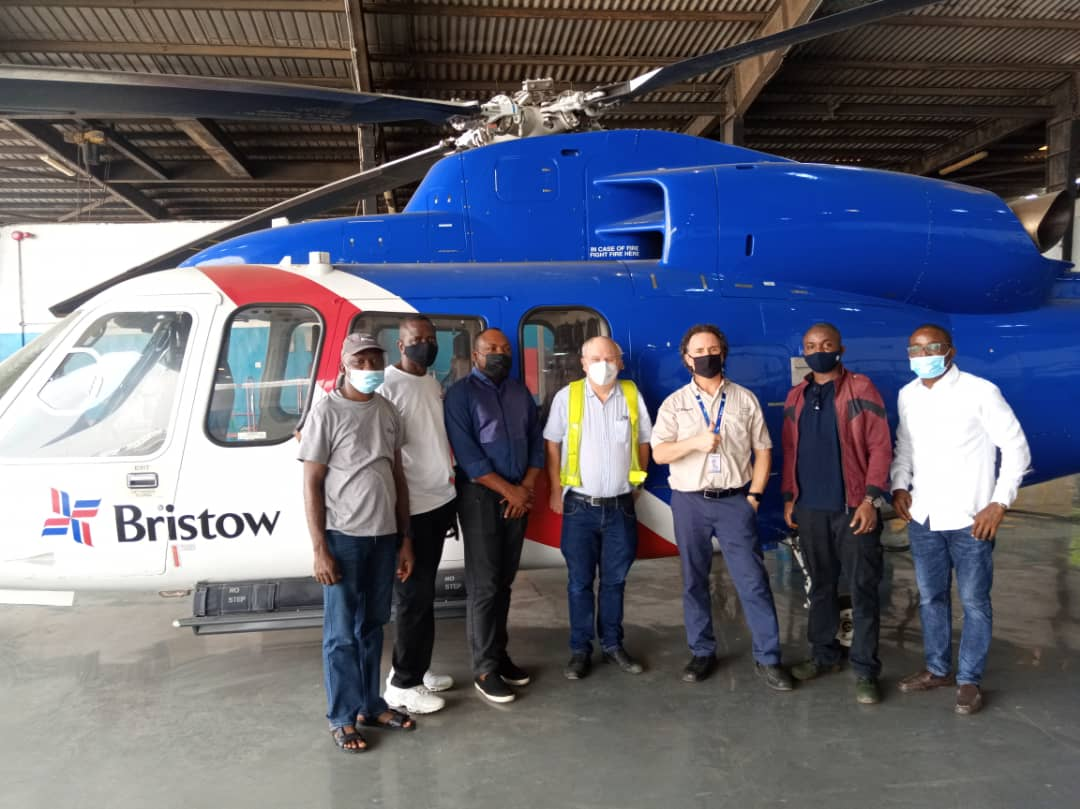 Half of the first Bristow class during practical training in front of an S-76